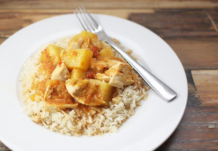 Instant Pot Mango Pineapple Chicken over Rice on white plate