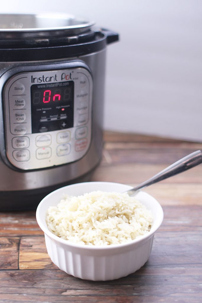 bowl of white rice in front of instant pot